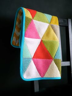 Triangle crochet blanket - I like the way it seems like it would have some pleasant weight to it when backed and bound like this.