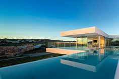 Strikingly sleek, this ultra-modern villa redefines the expectations of Algarve real estate by being family-friendly yet über-stylish. Inspired by the streamlined Bauhaus aesthetics, the luxurious villa enjoys pure white lines, open floor plans and easy indoor-outdoor flow, combined with an abundance of glass.
