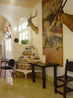 Hemingway's home in Cuba./I want the magazine rack Hemingway Cuba, Ernest Hemingway House, Fresco, Nobel Prize In Literature, Trophy Rooms, Wrought Iron Gates, Havana Cuba, Inspired Homes, Beautiful Islands