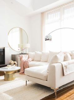 MARIANNA HEWITT HOME TOUR | LIVING ROOM - SECTIONAL COUCH - CHUNKY KNIT BLANKET  - MARBLE TABLE - GALLERY WALL - HIGH CELINGS - NEUTRAL COLORS - BLUSH PINK  - SHEER CURTAINS