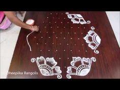 easy kolam with dots easy kolangal designs with 11 * 5 dots very easy rangoli latest rangolis Best Rangoli Design, Rangoli Designs Flower, Rangoli Kolam Designs, Rangoli Designs With Dots, Kolam Rangoli, Flower Rangoli, Rangoli With Dots, Beautiful Rangoli Designs, Sankranthi Muggulu