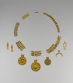 Old Babylonian / Mesopotamian Gold Necklace, pendants and beads; ca. 18th–17th century B.C. Geography: Mesopotamia, said to be from Dilbat Culture: Babylonian Medium: Gold Dimensions: L. 42 in. (3.6 cm) D. of largest medallion 1 3/8 in. (3.6 cm) Classification: Metalwork-Ornaments Credit Line: Fletcher Fund, 1947; Metropolitan Museum of Art, New York, NY; Accession Number: 47.1a-h. These gold pendants and beads exemplify the finest craftsmanship.