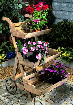Wooden trolley featuring three tiered shelves for setting flower pots makes another patio idea for Piper.