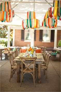 Giant lanterns, chandeliers, and suspended pieces of that ilk are requisite for a perfect wedding day. Find ones on Etsy you like, and perhaps they can stay up summer-round, or be swapped out from time to time for a different outdoor party look.