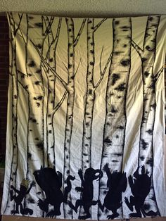 A moveable mural: This is a canvas drop cloth I painted with birch trees and the silhouettes of the characters from Where the Wild Things Are. They are having a wild rumpus and will help decorate a little boy's birthday party.