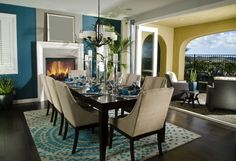 Contemporary Dining Room with Cement fireplace, Hardwood floors, Chandelier