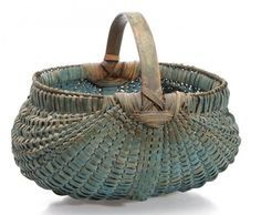 "Sold $1,200 SHENANDOAH VALLEY OF VIRGINIA PAINTED RIB-TYPE WOVEN-SPLINT BASKET, white oak, kidney form with double rim, arched handle with complex stepped supports, and fancy woven-over base rib. Outstanding original dry blue-painted surface. Late 19th/early 20th century. 10"" HOA, 7"" H rim, 10"" x 10 1/4"" rim.  Provenance: From the private collection of Dr. Charles and Elizabeth Umstott, Newport News, VA. Purchased from Mary Cramer, Bridgewater, VA."