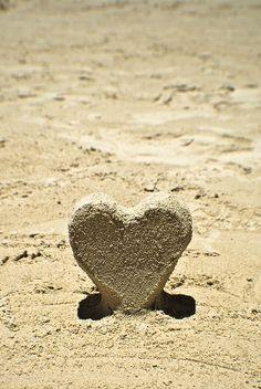Beach Lover balance wedding rings on the heart....