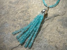 """The Hermione: A 19"""" tassel necklace in the gemstone of your choice, this piece hangs higher than my other tassel necklaces. Seven tassel strands hang from a 99% silver rosebud with sterling findings."""