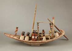 Model Sailing Boat with Mummy Period: Middle Kingdom Dynasty: Dynasty 12 Reign: Amenemhat II, late Date: ca. 1900–1885 B.C. Geography: From Egypt, Memphite Region, Lisht South, Mastaba B (Djehuty), South Area, between mastaba and south enclosure wall, MMA excavations, 1930–31