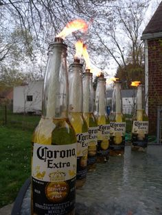 DIY Corona Tiki Torches man would I waste a lot of beer since I dont drink, but this would be hilarious!