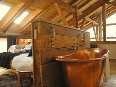 love this copper bath with the wood