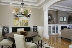 Living room: Benjamin Moore, Mesa Verde Tan, flat latex.  Dining room: Benjamin Moore, Bleeker Beige, flat latex
