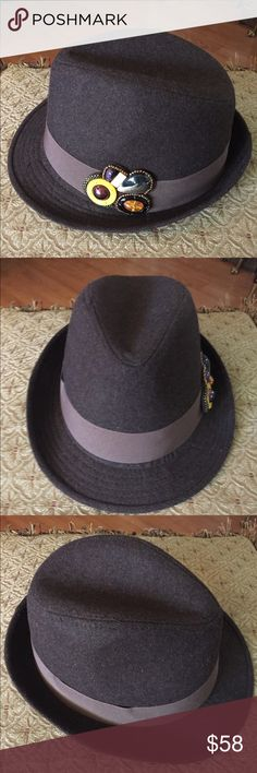 """Brown Wool Fedora Hat w Faux Stone Embellishments This fantastic Brown Wool Felt Fedora Hat has a brown grosgrain ribbon band surrounding the brim & finishes w/a fancy cluster of faux bakelite, amber and semi-precious stone embellishments. Inside lined in black comfort fabric and circumference lined in black ribbon. MAGID HATS. In excellent, like new preowned condition. Inside circumference 22"""". Smoke-free home. Unisex. Magid Accessories Hats"""