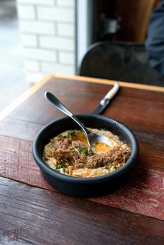 """The """"Deluxe"""" Hummus: creamy hummus mixed with pine nuts, almonds, smoked paprika – then topped with braised lamb neck. At Olio 
