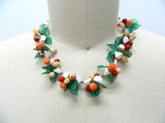 Vintage 1930s - 1940s Fruit Necklace...Fruit Salad Necklace...Plastic Fruit w/ White Beads...Great Colors...Marked Germany by oldeonthesquare on Etsy https://www.etsy.com/listing/474815071/vintage-1930s-1940s-fruit-necklacefruit