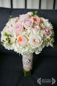 Wedding bouquet in soft colors.  Blush or light pink roses and peonies #weddingdesignstudio