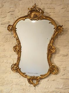Mirror and #gilt wood and stucco, #LouisXV #style, decorated with shells and acanthus leaves. The edge of the glass is beveled. #19th century. For sale on Proantic by Franck Gonnetan.