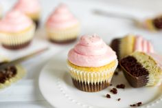 Neapolitan cupcakes sitting on a plate.