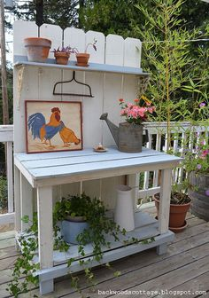 Fall Potting bench makeover. The back of hisis made with a section of fence.