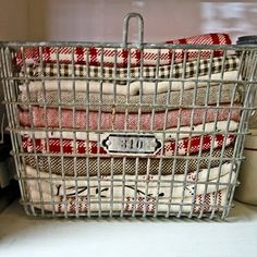 Good idea for displaying my tea towel collection in my built-in. Now where do I buy good quality metal baskets?