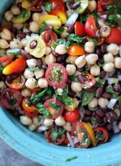 Middle Eastern Chickpea & Black Bean Salad I added red pepper, corn and sun dried tomatoes to the salad and cumin and paprika to the dressing. Topped with a sprinkle of feta. Delish!