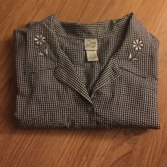 Button up plus size top Dark blue and white checked button up shirt. It's light weight and very comfortable. Size 30/32 no rips, tears or stains. Make a wonderful addition to your closet. Tops Blouses