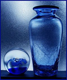 Blue glass. Love the texture at the bottom of the vase.