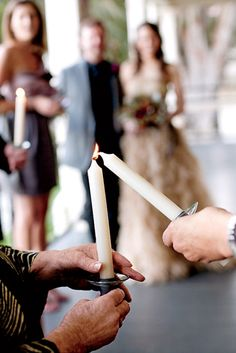 6. Include The guests in the Unity Candle Ceremony  Normally in a unity candle ceremony, the bride and groom each take their own candlesand use ...