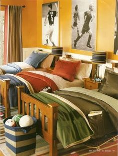 Great idea for a boys shared bedroom - or a single bedroom. Love the posters of sport stars! Adore the colours.