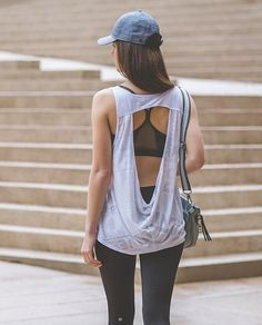 This super lightweight tank was designed with a breezy fit and an open back so we can continue to cool down even after we leave the studio. | Next To Nothing Tank