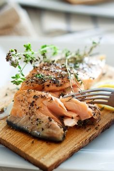 Smoked Salmon with Mustard and Dill: Ingredients: -2 cups wood chips -1 tablespoon minced fresh dill -1 tablespoon fresh lemon juice -3 tablespoons sweet-hot mustard (such as Inglehoffer) *or you can use regular mustard -1/2 teaspoon salt -1 (1 1/2-pound) salmon fillet -Cooking spray