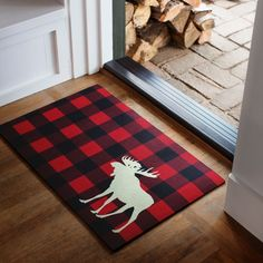 Designed in our studios exclusively for Simons Maison A traditional pattern in an urban lodge style for the hall Accent moose silhouette on large hunter check Easy-care and easily wipes clean with a damp cloth Durable rubber back 45 x 70 cm Moose Lodge, Moose Hunting, Hunting Gear, Country Decor, Rustic Decor, Moose Silhouette, Moose Decor, Moose Art, Plaid Decor