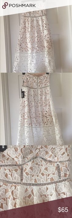 White Lace Dress 🍭NWT, only reason I'm selling is it was way too small for me in the chest area. It says it's a small, but I'm listing it as an XS. I believe the sizing is off due to the type of material and the added lining, there also isn't much stretch if any at all. It's a gorgeous dress!!!! Such a great one for Sunday brunch or a night out🥂 Lining goes to knee level. Straps are included, but optional. Elastic on chest area to help keep it up, zip on back. So many details on this one I…