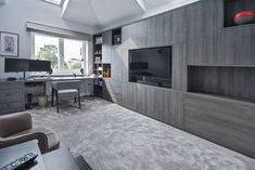 Wonderfully done veneer. Custom built spaces for the TV and electronics. Complementary colours to match the room's aesthetic.