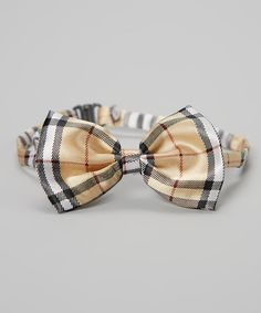 Paired with a button-up or even a plain tee, this modern bow tie will have any young trendsetter looking super stylish. Because it features an adjustable neck band and simple hook closure, it's easy and comfy to wear and will fit as little ones grow.