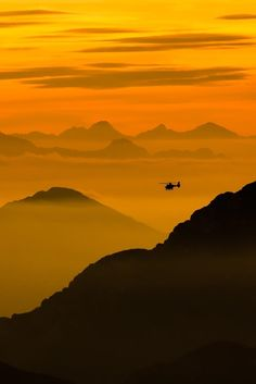 Flying through the Alps by Mauro Cattelani on 500px, #helicopter #orange sky #mountains