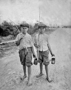 Vintage photo of two boys with their homemade fishing rods . Texas, c1925.