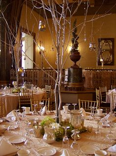 Silver Branched Tree Centerpiece with a Floral Base of Green and White Hydrangea and Fuji Mums