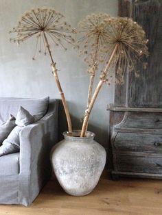 Dried allium heads in a rustic pot make a perfect and unusual flower arrangement! #CavetoCrib