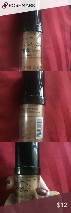 LA Girl pro hd coverage foundation warm beige L.A. Girl foundation in shade warm beige. The tip of my nail shows how much i used. Really nice full coverage L.A. Girl Makeup Foundation