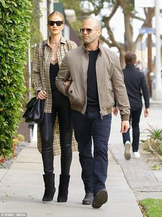 Just the two of us: Rosie Huntington-Whiteley and Jason Statham enjoyed some alone time on Saturday as they embarked on a spot of last-minute Christmas shopping in LA Rosie And Jason, Jason Statham And Rosie, Jason Statham Rosie Huntington, Top Hollywood Actors, Mature Mens Fashion, Bald Men Style, African Blouses, Winter Outfits Men, Bomber Jacket Men