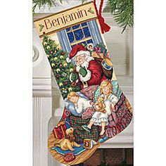 @Overstock - Crafting enthusiasts will adore this cross-stitch stocking kit. This kit includes everything to stitch your own holiday stocking with a stitched personalized name. The Christmas stocking measures 16 inches long and features a detailed holiday scene.http://www.overstock.com/Crafts-Sewing/Sweet-Dreams-Counted-Cross-Stitch-Stocking-Kit/3344165/product.html?CID=214117 $25.33