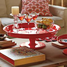 Red Pedestal Tray. A use for all them pretty cake plates I see at flea markets. Never thought of putting them on my coffee table.