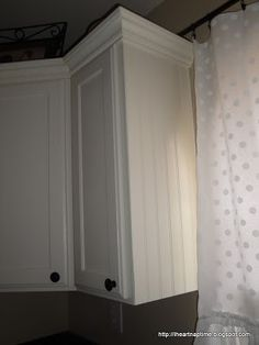 How to paint kitchen cabinets. Adding molding at top of cabinet.