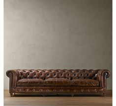 RH's Kensington Leather Sofa:A masterful reproduction by Timothy Oulton of the classic Chesterfield style, our sofa evokes the grand gentlemen's club tradition.