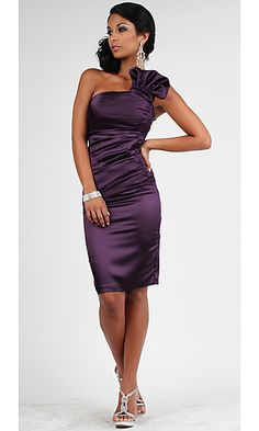 Go ahead and show off in this sexy but classy cocktail dress by Atria for prom, cocktail or special occasion party. You'll look fabulous in this shimmering stretch satin semi-formal party dress. Slight ruching across the straight bust with an out sized ruffle at the one shoulder strap creates drama. Asymmetrical ruching across the body ensures a flattering fit while the knee length skirt assures that this stunner is perfect for any special occasion.