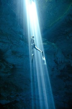 Free diving: Cenote Mexico. 'Cenotes have an almost mythical quality – they were sacred to the Mayans who believed they were the gateway to the afterlife and used them for rituals, including human sacrifice. These photographs were taken at cenote called The Pit near Tulum. The light pierces the cool dark waters, providing an ethereal backlight to the caves and caverns below.'  Eusebio Saenz de Santamaria, Australian freediver