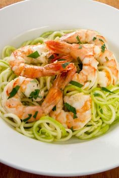 This quick and easy garlic roasted shrimp with zucchini pasta recipe is a great weeknight paleo dinner — you can have it on the table in 20 minutes. | cookeatpaleo.com/garlic-roasted…zucchini-pasta