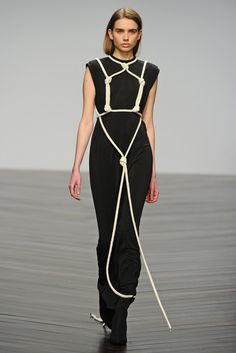 I have always really liked the Japanese art of tying knots on human bodies.  I'm guessing that was inspiration for this dress in Eilish Macintosh's Fall RTW 2013. Really cool idea!
